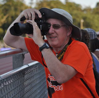 Scott Durham capturing runners running by during a track meet.
