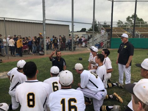 Hughson High Baseball head coach Charly Garza addresses his team following a 10-7 win over No. 6 Amador