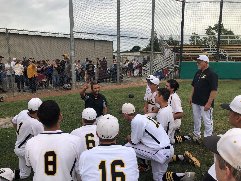 Hughson High Baseball head coach Charly Garza addresses his team following a 10-7 win over No. 6 Amador